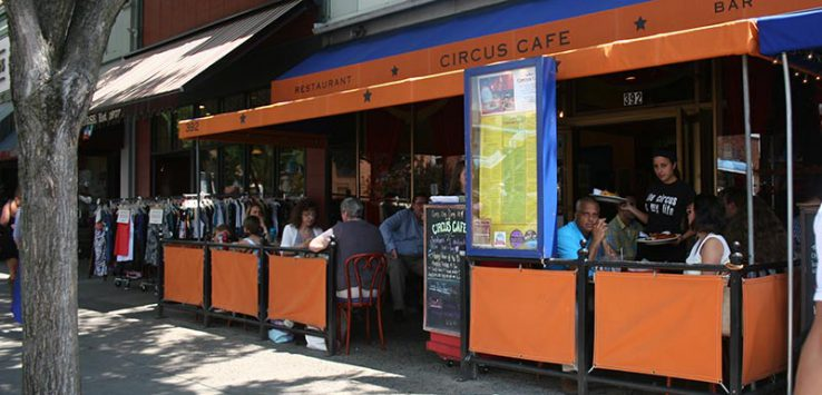 street view of circus cafe with orange sign